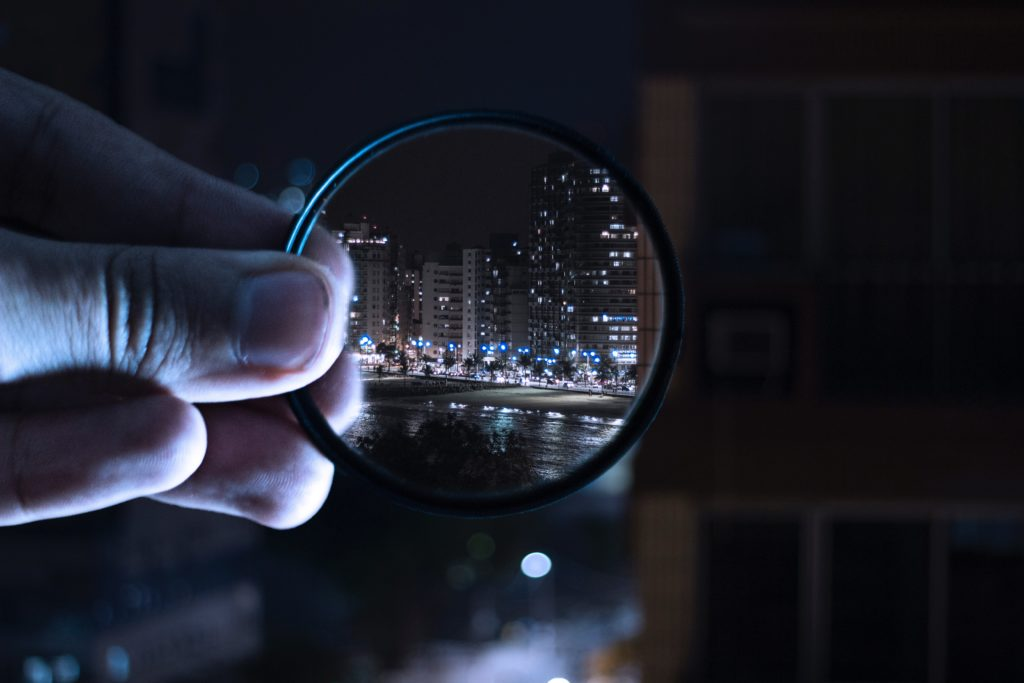 Magnifying glass looking on a city