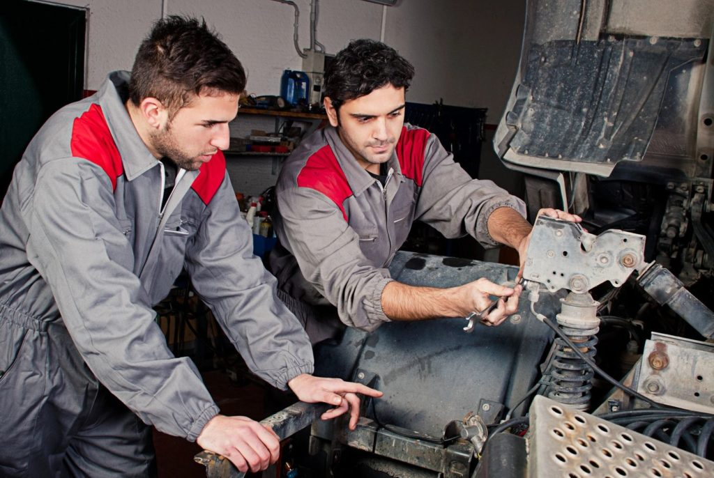 Lead Diesel Mechanic teaching an apprentice mechanic